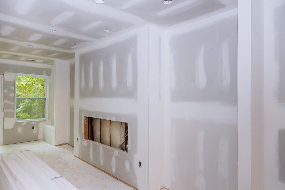 drywall being repaired inside a house