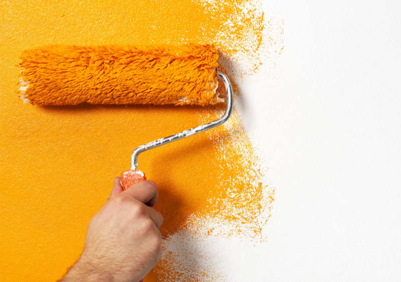 paintbrush painting a wall