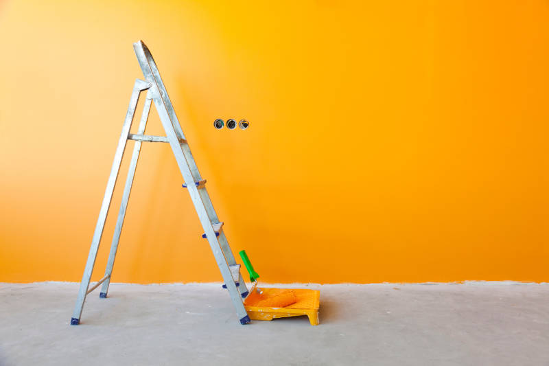Brightly painted wall with a painting ladder