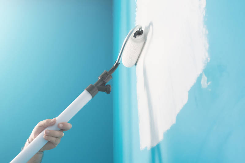 Interior wall being professionally painted